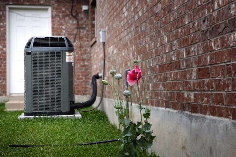 AC unit outdoors near a home.